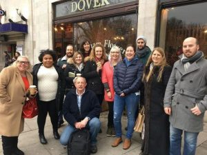 Mental Health Mates walk attendees in front of florist outside Clapham South Tube Station